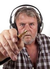 Eldery man is wearinga headphone