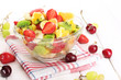 glass bowl with  fresh fruits salad and berries