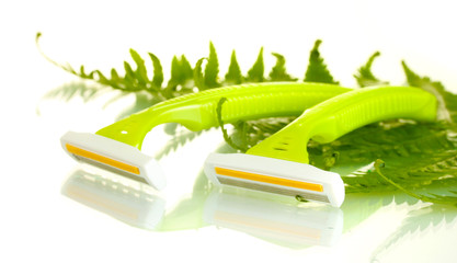 woman safety shavers and leaf isolated on white.