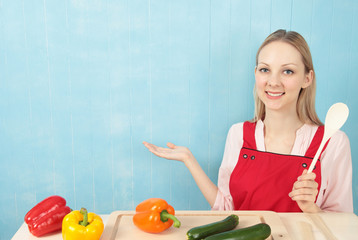 Woman in Apron with Vegetables