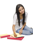 Young student working with books and notepad