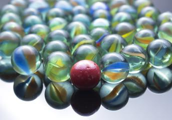 Marble ball on glossy floor