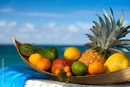 Tropical fruit basket , sea  on the background