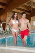 Young couple enjoy spa pool