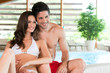 Happy couple at wellness spa