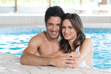 Loving couple at spa pool