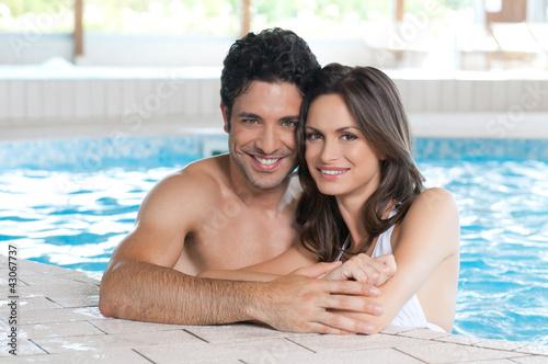 Loving couple at spa pool