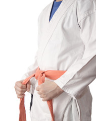White kimono and an orange belt.