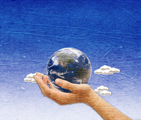 Hand with earth over the blue sky  background embeded on paper t