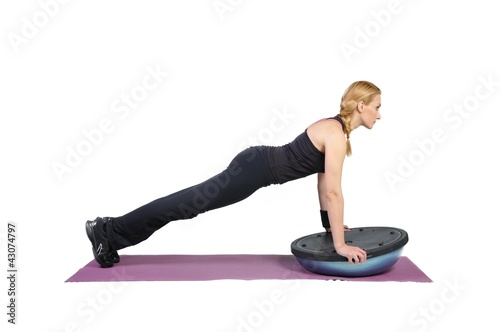 Fit young female pilates instructor showing different exercises