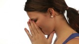Sad young woman crying isolated