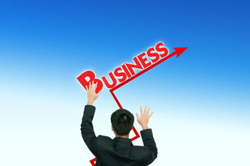 A business man placing business words on the blue sky,growth