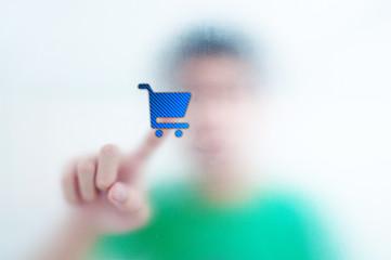 Human finger pressing Social Network icon shopping cart button