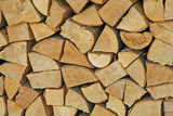 woodpile in the Woodshed ready to burn and heat poster