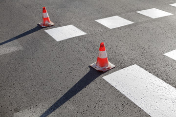 Roadworks, pavement and traffic cones