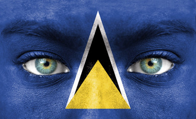 Human face painted with flag of Saint Lucia