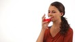 Young woman drinking red wine isolated