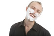 man with shaving foam on face before shaving