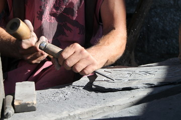 Chisel  tool hammer in hand working