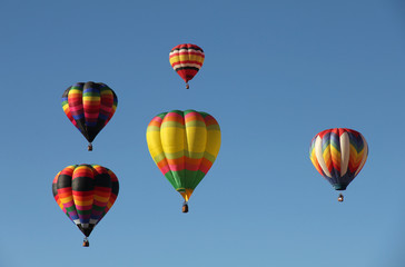 Colorful Hot Air Balloons Floating Against a Blue Sky