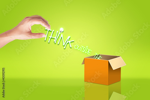 Hand holding think out side the box text for concept idea плакат