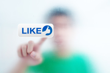 man pressing a touchscreen like button