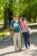 Young couple looking at map in park