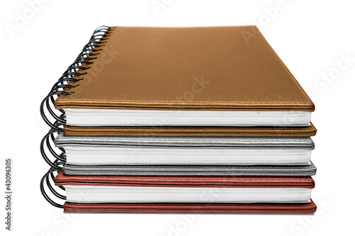 three notebook isolated on white