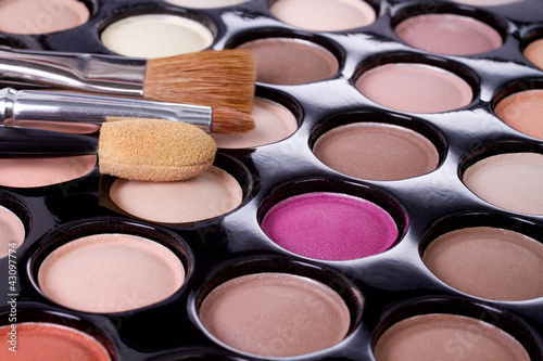 make-up colorful eyeshadow palette with brushes closeup