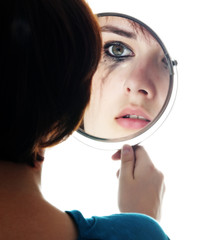 young girl looking in the mirror and crying - sensitive eyes..
