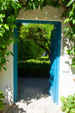 door to garden with orange tree