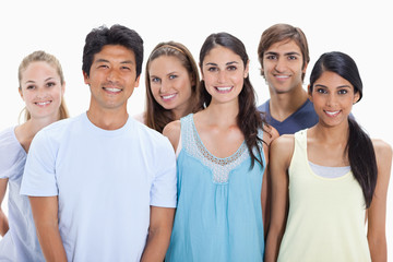Close-up of people smiling together