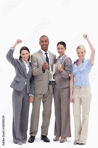 Happy business team holding a cup