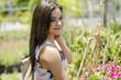 Gorgeous woman buying flowers in a nursery garden