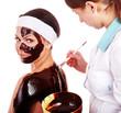 Girl having chocolate body mask.