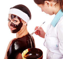 Girl having chocolate body mask.