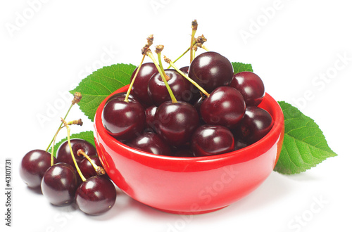 Cherries in red bowl