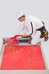 worker cut ceramic tile machine tiling joint crosses