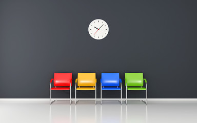 Colored stools and wall clock in the waiting room