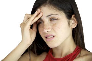 Closeup female model suffering headache holding her head