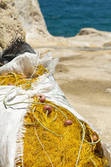 A pile of fishing nets stored in a sack