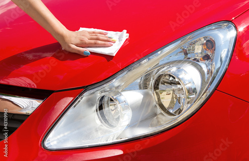Young girl polishing car