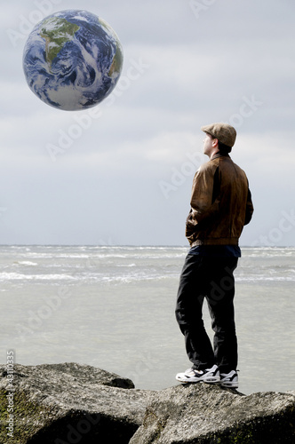 Man on Jetty with Earth