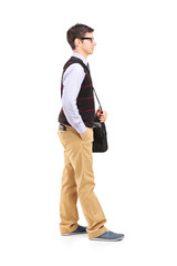 Full length portrait of a male student standing in line