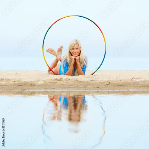girl training on beach