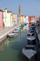 canal in Burano little village on Venetian lagoon ,vivid painted