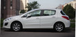 Car Peugeot 308 white color side view