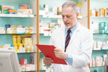 Pharmacist reading a prescription