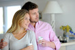 Portrait of in love couple standing at home