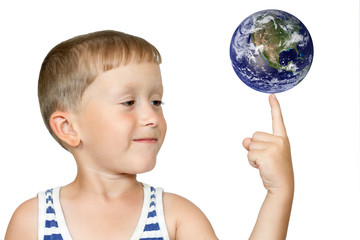 Boy turns the globe on finger